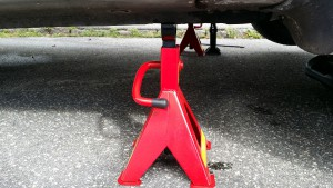 jack stand fitted beneath car